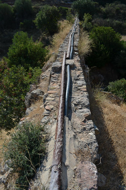 Loukou: Roman aqueduct bridge 8, modern water pipes, looking SE