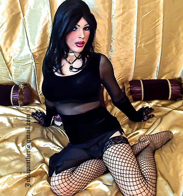 Gothic look: black velvet dress and fishnet