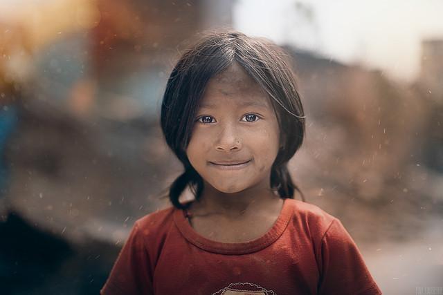 Little girl among the debris after earthquake