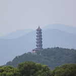 Pagoda against the misty hills of Beijing