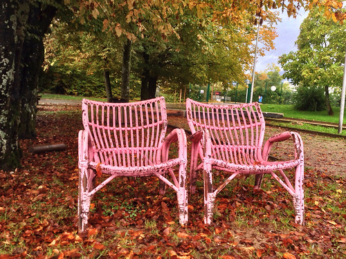 Pink chairs rotting in the autumn weather | by andrew_maier