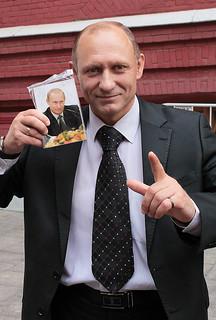 Model posing like Mr.Putin by the Kremlin Wall. Moscow