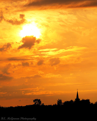 sunset sky orange cloud church silhouette fire glow cross dramatic steeple