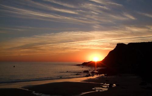sunset beach portugal rock arrifana