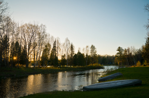blue trees light sunset lake wet water grass yellow landscape evening boat spring woods aluminum cove michigan canoe