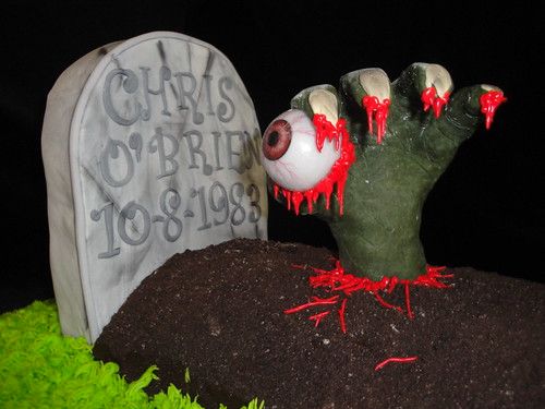 Zombie hand and grave | by kyliescustomcakes