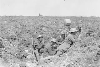 British Royal Garrison Artillery using a daylight signalling lamp in a shell hole in front of Fricourt Wood, September 1916, by John Warwick Brooke | by Royal Opera House Covent Garden