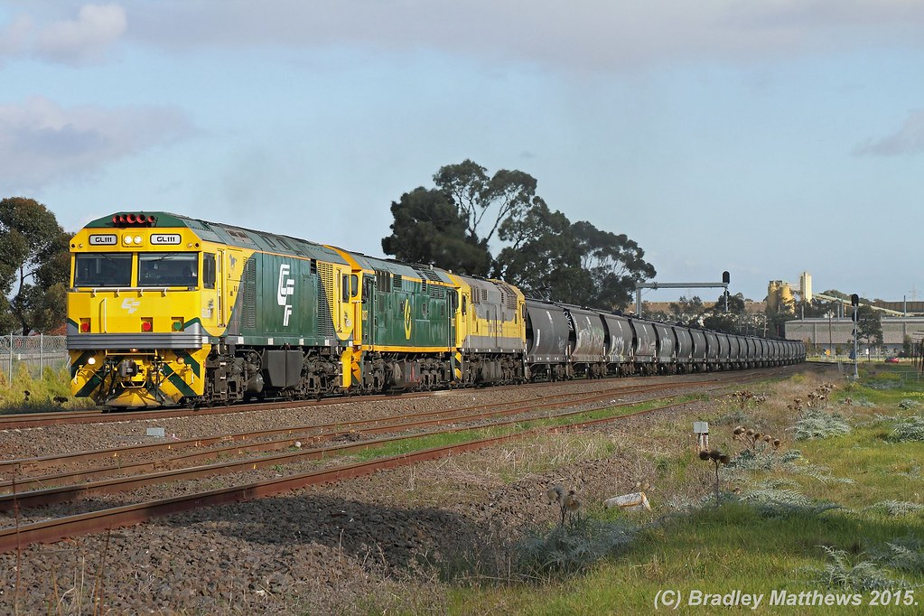 GL111-8037-8030 with 7737 down empty Qube SG grain from Nth Geelong to Somerton, later on 5MC5 to Henty at Albion Junction (2/7/2015) by Bradley Matthews