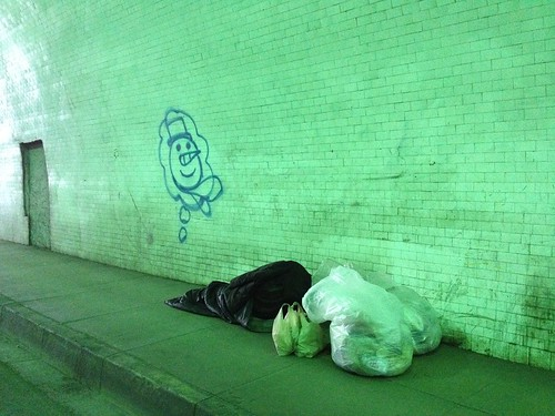 Homeless man sleeps adjacent Snowman themed graffiti in 2nd Street tunnel, Los Angeles | by ubrayj02