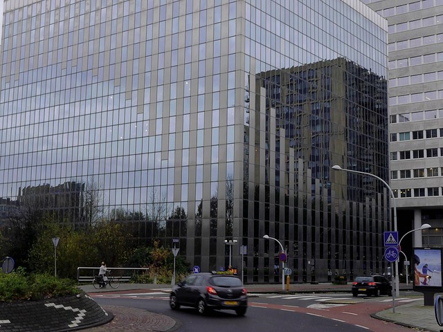 Free photo of Amsterdam: picture of Dutch Sky in the windows of modern architecture in the light of November, along the Ring - The Netherlands