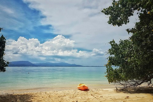 tropical island sea sun sand paradise sky clouds water blue green mangrove jungle trees boat canoe kayak yellow peace peaceful serene relaxed relax worryfree warm hot thailand travel holidays vacation tourism poster postcard phone mobile cellphone smartphone phonecam iq resolution detail quality image stock samsung galaxy s7 samsunggalaxys7 android snapseed picsaypro