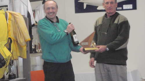 Jeff Coffin receiving from Will Perry the Basin Trophy for first Senior placing in the Closing Regatta | by PLSC (Panmure Lagoon Sailing Club)