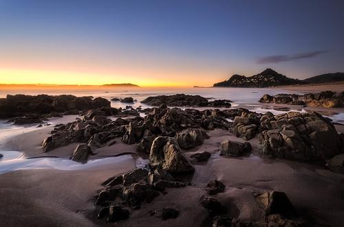 sea newzealand seascape sunrise nikon rocks nz northisland coromandel eastcoast tairua nofilters colourimage 1024mm d7000