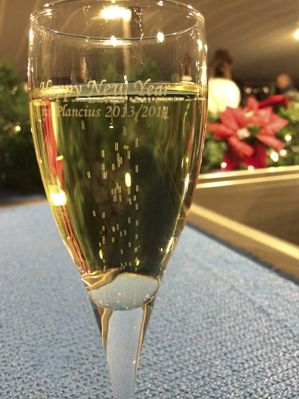 """Champagne Glass saying """"Happy New Year Plancius 2013/4"""""""