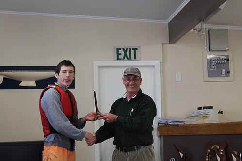 Andrew Coffin, Junior winner of the Handicap Series being presented the Smith Trophy by Will Perry | by PLSC (Panmure Lagoon Sailing Club)