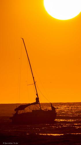 orange sun gulfofmexico catchycolors boats florida jetty silhouettes sunsets fav20 boating fav15 gf1 fav10 fav5 views500 views100 views200 views400 views300 cloudsstormssunsetssunrises sunsetsniper