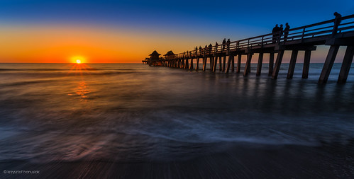 ocean blue sunset sky people orange reflection silhouette pier waves glow gulf unitedstates florida horizon crowd naples boardwalk fl bluehour hanusiak