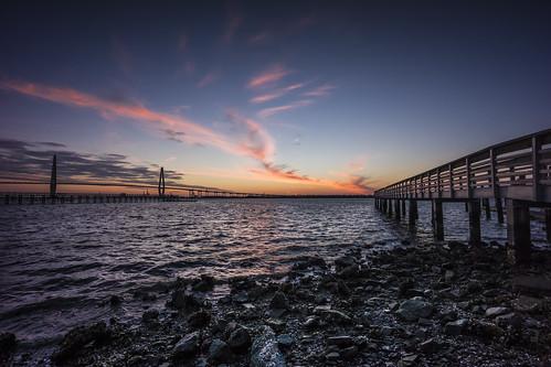 sunset sky beach pier fishing dock waves dusk south southcarolina charleston mtpleasant charlestonharbor ravenelbridge arthurraveneljrbridge sonynex7