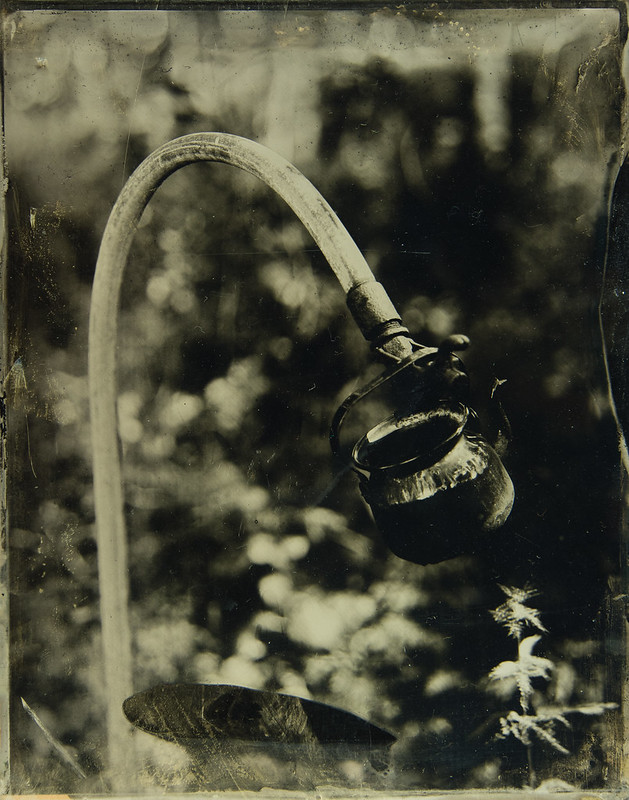 An old coffee kettle and waterpost