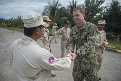 U.S. Navy Chief Petty Officer Kristopher Sharrock shakes hands with a Royal Cambodian Navy sailor following a preventive maintenance class as part of CARAT Cambodia. (U.S. Navy/CPO Lowell Whitman)