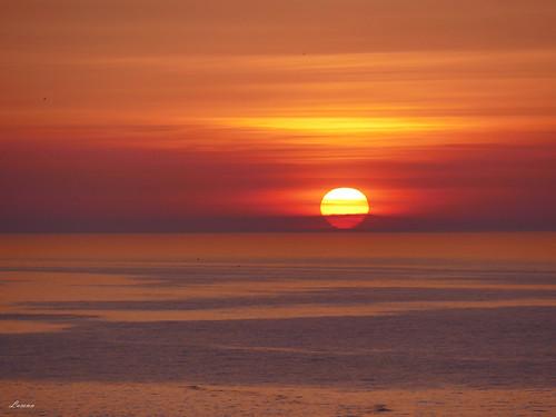 barcelona sunrire balearicsea mediterranean catalunya ocean water sky clouds colors orange fireball red seascape horizon travel panasonic fz1000