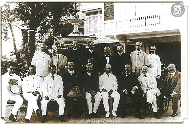 Governor-General Forbes sits with his Cabinet in front of the Palace fountain