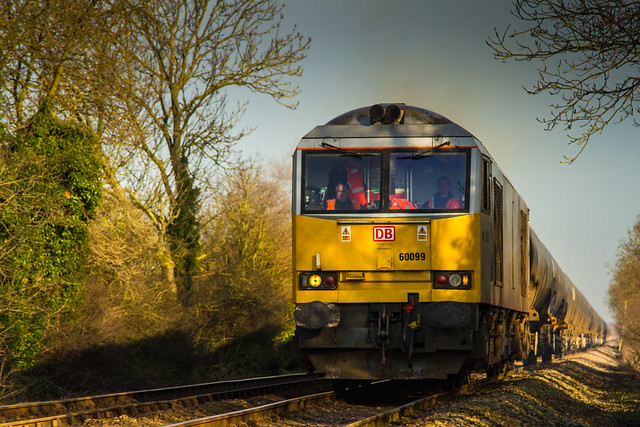 DB Class 60 no 60099 crosses Rolleston Foot crossing on 20-01-2014 with the 6M00 Humber to Kingsbury loaded tanks