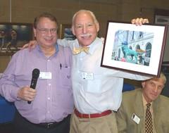 Steve Wood  gave Cubs fan Richard Adelman a photo of a statue wearing a Cubs baseball cap.