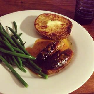 Tess's baked sausages with tomato sauce, green beans, and baked potato | by Texarchivist