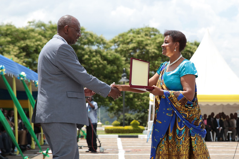 Speaker of Parliament, Donatille Mukabalisa, presents an award to one of the winners - Kigali, 02 November 2013