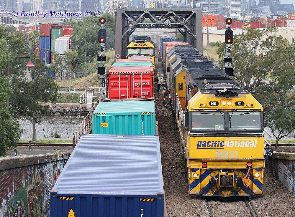 NR43-NR52 with 3BM2 freight from Brisbane cross with NR51-DL43-DL41 with 4MC2 freight to Grifffith at Bunbury St, Footscray (20/11/2013) by Bradley Matthews