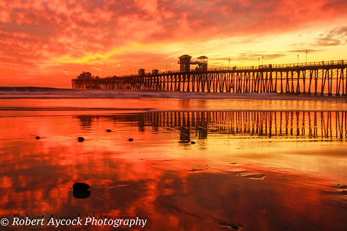 reflections southerncalifornia oceansidepier firesky oceansidecalifornia canonphotography robertaycock