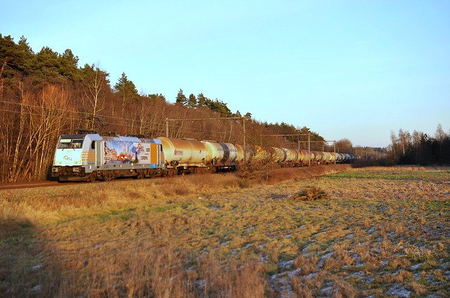 HSL Polska with a train in the last light of