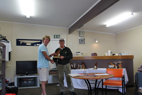 Andrew Irving, winner of the Closing Regatta being presented the Basin Senior Trophy by Will Perry | by PLSC (Panmure Lagoon Sailing Club)