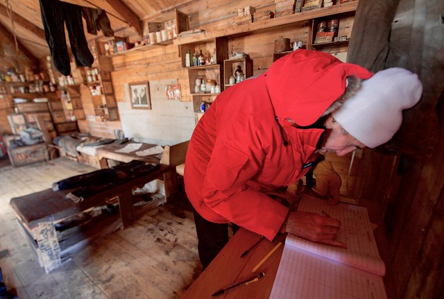 Secretary Kerry Signs a Guestbook inside the hut Where Explorer Ernest Shackleton and 14 Other men Lived in 1908