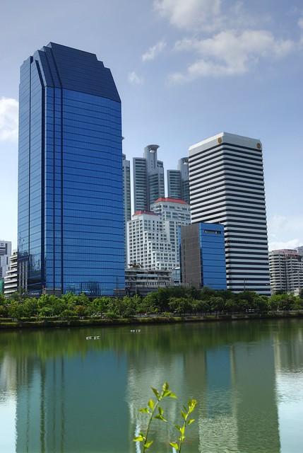 High rise buildings next to the lake in Benjakiti Park, Bangkok, Thailand