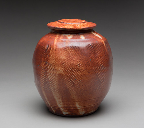 Warren MacKenzie (American, b. 1924)  Lidded Container, 2012  Stoneware with Shino glaze  9 x 7 1/2 in. diameter (22.86 x 19.05 cm)  Milwaukee Art Museum, Gift of Katherine Duff Rines M2012.497a,b Photo credit John R. Glembin