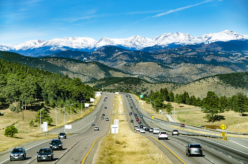 colorado geneseemountain rockymountains rockies mountain snow vista interstate70 i70 cars median hill roadsigns sky traffic trees evergreens downhill scenic automobiles continentaldivide snowcapped