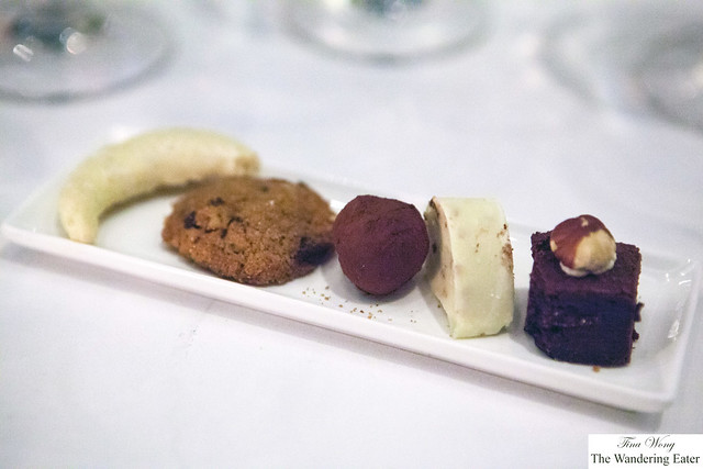 Chocolate bonbons, mini brownie topped with hazelnut and chocolate chip cookie