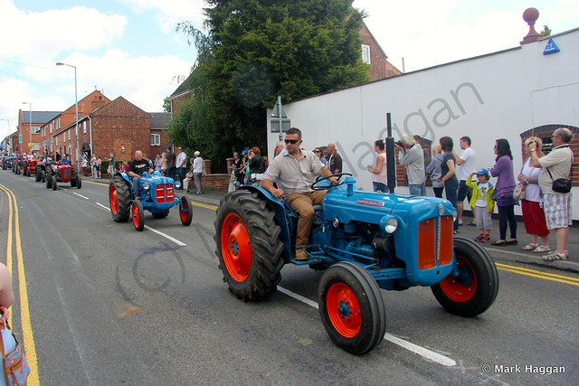 The tractors parade through the village