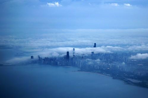 cloud chicago skyline clouds plane airplane