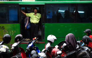 Passenger in the door of a bus in Yogyakarta | by marius.stankiewicz