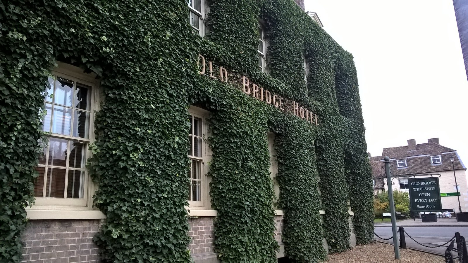 Old Bridge Hotel Huntingdon Moss covered building near the river.