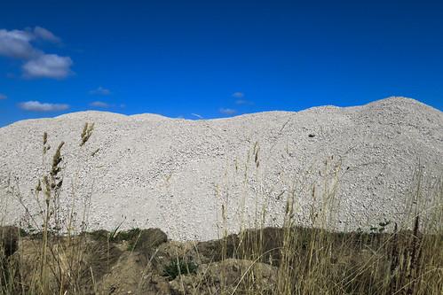 recycledaggregate mound pile constructionsite weeds grass desmoines s216thstreet washingtonstate usa 2016 blinkingcharlie canonpowershotg9x