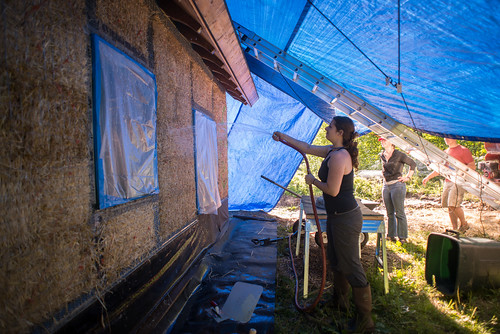 Tara Spraying Strawbale Walls Before Plastering | by goingslowly