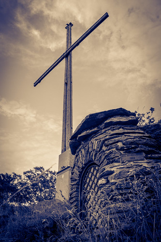 Cross on the summit of a mountain | by Groman123