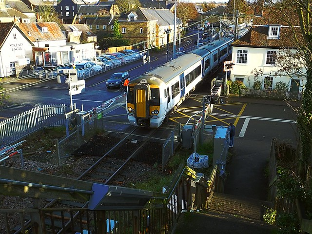 379 006 departing Ware Station, with the 13.05 Broxbourne - Hertford East stopper, passing over Amwell End Crossing. 11 12 2016