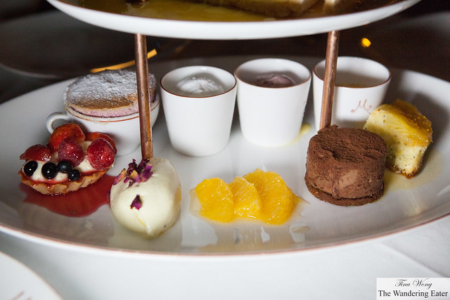 The bottom section of the dessert platter