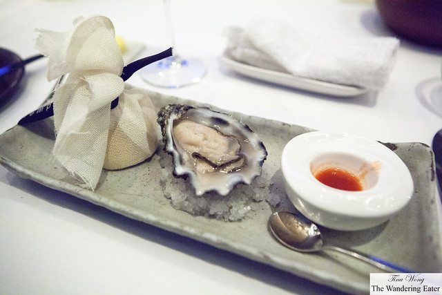 Oyster (from French region) on the half shell served with Tabasco sauce