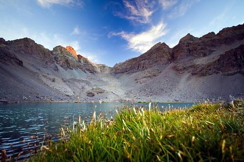 sunset lake mountains grass clouds sierra alpenglow
